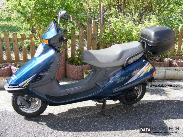 скутер хонда 125 фото