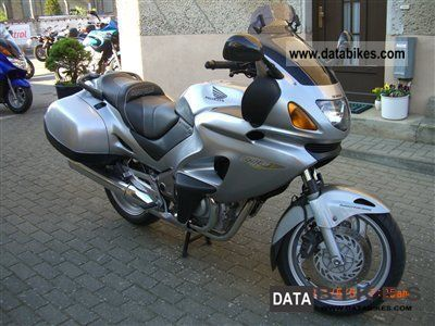 2003 Honda  NTV 650 Revere, Tourenkrad with accessories Motorcycle Naked Bike photo